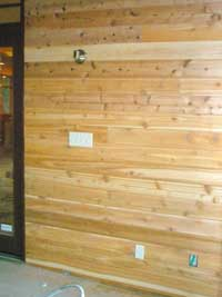Ship-lap cedar paneling on the wall of the 'bug room'