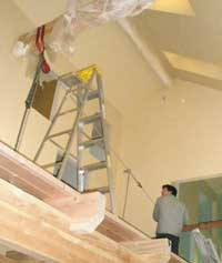 Spencer West operating the come-along to lift the stairway into place