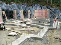 Rebar-reinforced concrete footers
